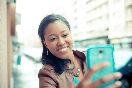 self conceit: beautiful african young woman selfie in the city Stock Photo