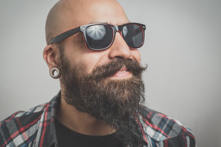 hipster long bearded and mustache man with shirt squares Stock Photo