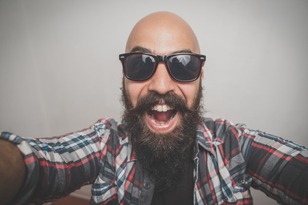 hipster long bearded and mustache man with shirt squares selfie photo
