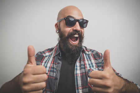 rea: hipster long bearded and mustache man with shirt squares Stock Photo