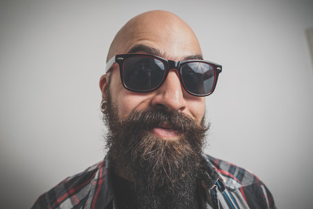hipster long bearded and mustache man with shirt squares photo