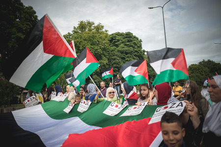 against the war: MILAN, ITALY - JULY 26: Pro Palestine manifestation held in Milan on July, 26 2014. People took to the streets to claim  Gaza and Palestine freedom against israel war and bombing