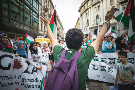 genocide: MILAN, ITALY - JULY 26: Pro Palestine manifestation held in Milan on July, 26 2014. People took to the streets to claim  Gaza and Palestine freedom against israel war and bombing