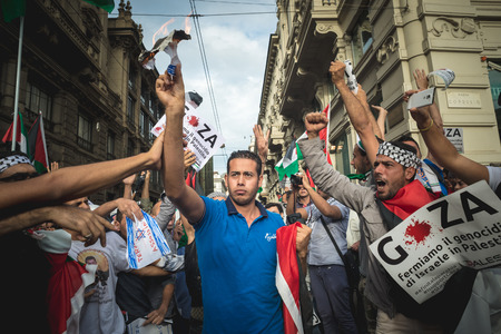 MILAN, ITALY - JULY 26: Pro Palestine manifestation held in Milan on July, 26 2014. man burning israel flag against war and bombing in palestine