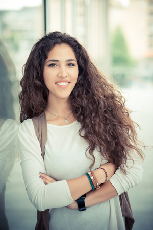 beautiful curly long brunette hair moroccan woman in the city