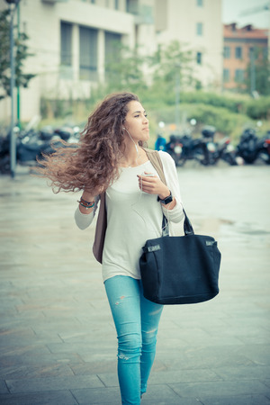 beautiful curly long brunette hair moroccan woman in the city photo