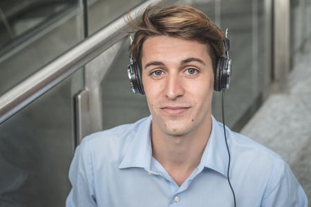 hansome: young model hansome blonde manwith headphones