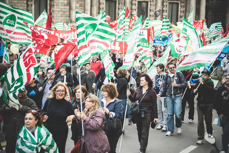 layoffs: MILAN, ITALY - OCTOBER 31: National Strike of tourism in Milan on October, 31 2013. Thousands of tourism workers take the street to protest against layoffs and cutbacks in the tourism
