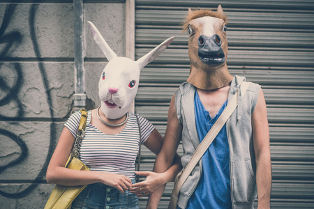 horse and rabbit mask couple of friends young  man and woman in the city Banque d'images