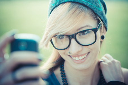 young beautiful model woman selfie in the city photo