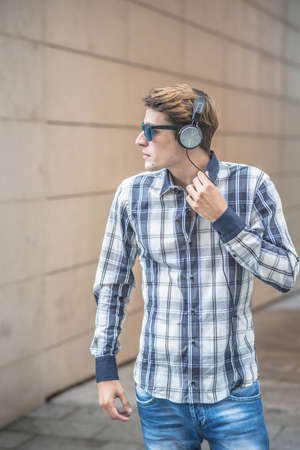 young model handsome blonde man in the city photo