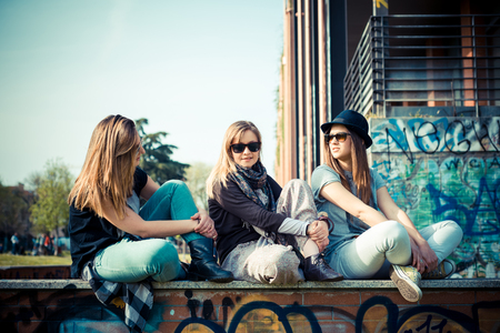 three beautiful friends authentic in urban contest photo