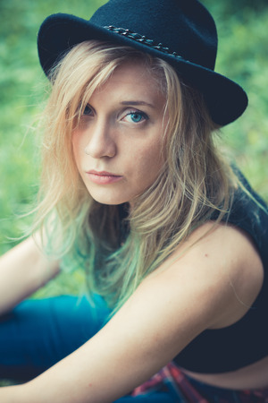 beautiful young blonde hair woman hipster in the city photo