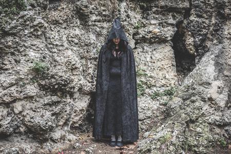 beautiful vampire: beautiful dark vampire woman with black mantle and hood halloween