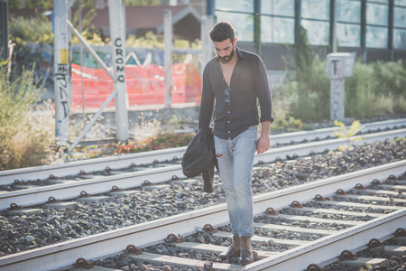appealing attractive: young handsome attractive bearded model man in urban context Stock Photo
