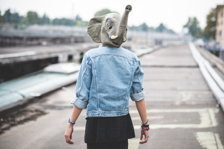 elephant mask young handsome bearded hipster man in the city photo