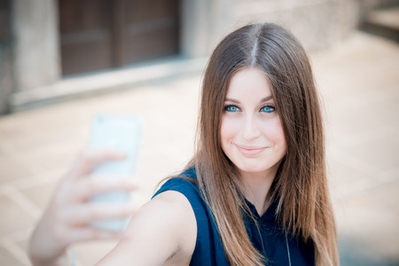 self conceit: young beautiful hipster woman take selfie Stock Photo