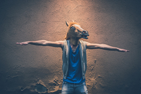 horse mask young hipster man in the city