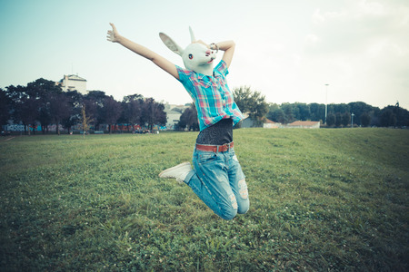 rabbit mask absurd beautiful young hipster woman in the city photo
