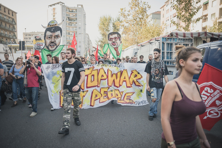 manifestation: MILAN, ITALY - OCTOBER 18: manifestation held in Milan october 18, 2014. People took streets to protest against racism, war and against lega nord, right wing politic italian movement