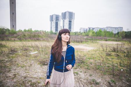 desolate: beautiful woman in a desolate lurban landscape