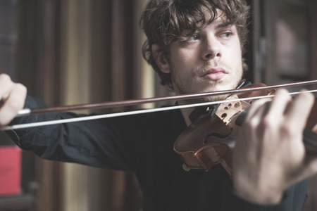 classical music: young handsome blonde italian violinist Stock Photo
