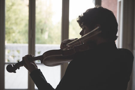 young handsome blonde italian violinist photo