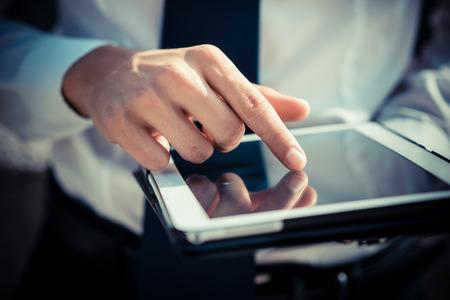 close up businessman man hand using tablet device outdoor Standard-Bild