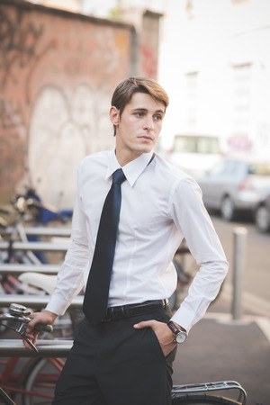 young handsome elegant blonde model man in the city photo