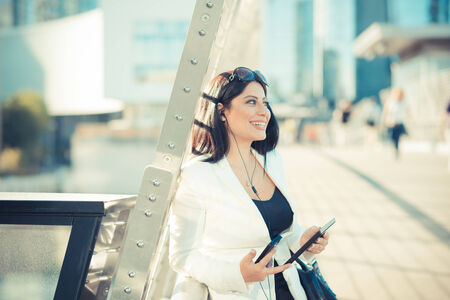 beautiful long black hair elegant business woman with tablet  in the city photo