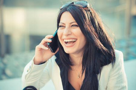 beautiful long black hair elegant business woman in the city photo