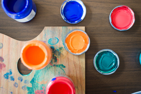 close up of colorful painter palette at home photo