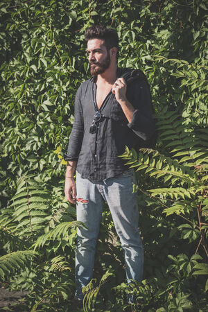 young handsome attractive bearded model man in urban context photo