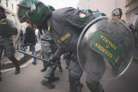 MILAN, ITALY - NOVEMBER 14: Student demonstration held in Milan November 14, 2014. police fighting against students during manifestation