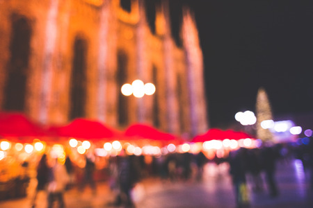 crowd source: blurred bokeh city milan by night in christmas time Stock Photo