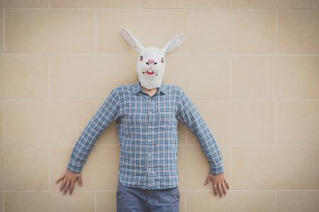 absurd: rabbit mask absurd man in the city Stock Photo
