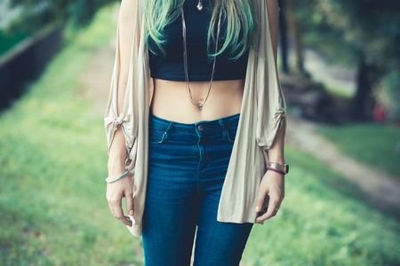 belly button: close up of belly button of young woman outdoor