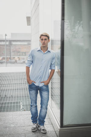 hansome: young model hansome blonde man in the city