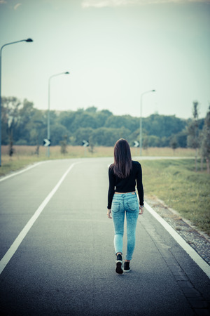 young beautiful brunette straight hair woman on the road outdoor Stock Photo