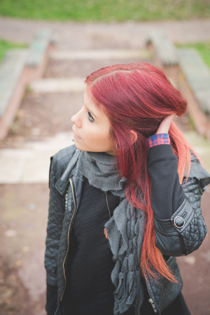 venezuelan: young beautiful red hair venezuelan woman lifestyle in the city of milan outdoor street