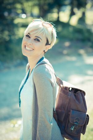 short hair: beautiful young blonde short hair hipster woman in the city