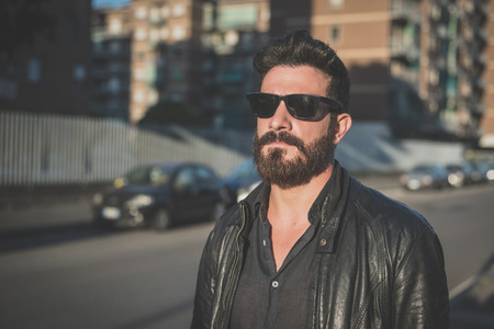 young handsome attractive bearded model man in urban context Archivio Fotografico