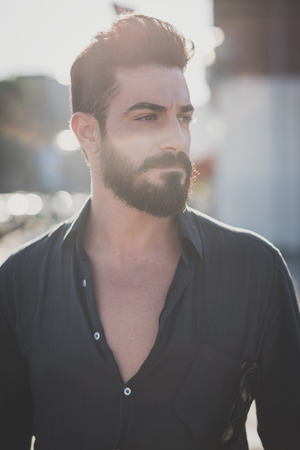 context: young handsome attractive bearded model man in urban context Stock Photo