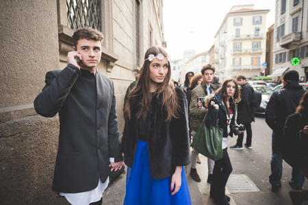 poser: MILAN, ITALY - MARCH 01: People during Milan Fashion week, Italy on March, 01 2015. Eccentric and fashionable people outside city during Milan fashion week wait for models and famous people Editorial
