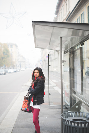 young beautiful indian woman in the city street autumn