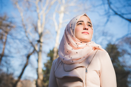 young beautiful muslim woman at the park in spring