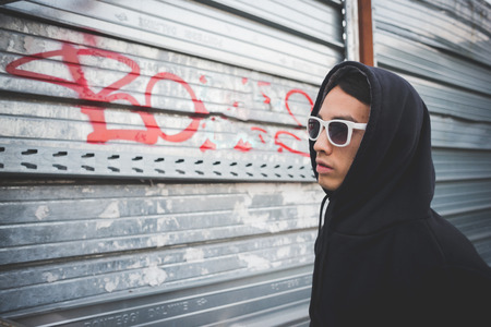 hip hop man: young asian hip hop man in town outdoor lifestyle Stock Photo
