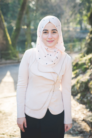 arab spring: young beautiful muslim woman at the park in spring