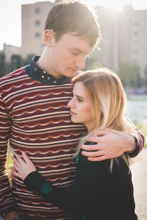 young couple lovers authentic in the city Stock Photo