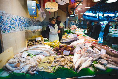 boqueria: BARCELONA, SPAIN - MARCH 21: La rambla Boqueria marketplace on March 21, 2015. Boqueria is the most famous marketplace in Barcelona, in front of la rambla street.